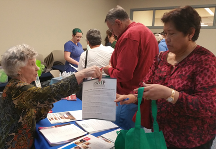 MA SMP Team Member helps a consumer at the Somerville Senior Center Health Fair on October 26, 2017.